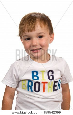 Toddler male child smiles and wears a shirt the says,