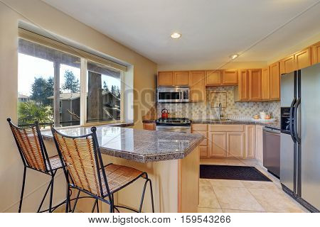 Kitchen Room With Honey Cabinets, Gray Counter Tops