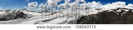 Huge Glacier Of Elbrus Mountain Close To Peak. Great Panorama Of Beautiful Snow Mountain Range Of Ca