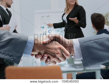 businessmen shaking hands after signing a lucrative financial co