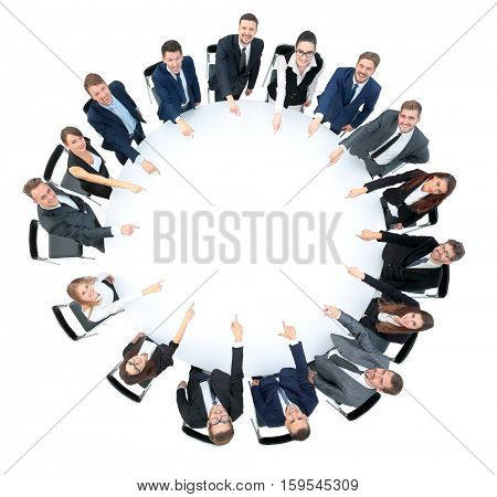 Happy business team pointing at something