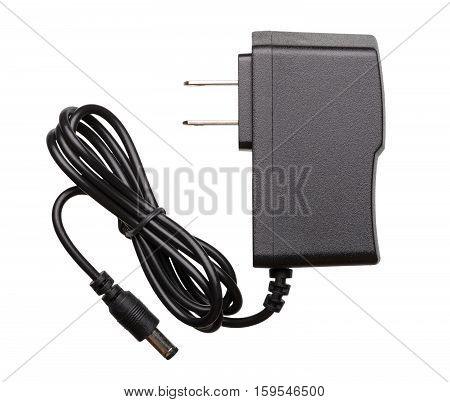 Universal power supply with US plug and twisted cord isolated on white background.