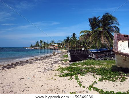 North End Beach Big Corn Island Nicaragua with old boats and hotel in background on Caribbean Sea