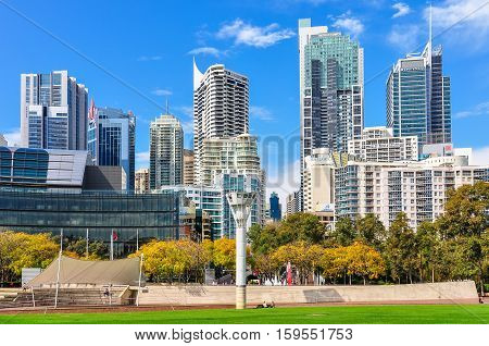 SYDNEY AUSTRALIA - AUGUST 29 2012: Skyscrapers as seen from the Tumbalong Park near Darling Harbour in Sydney Australia