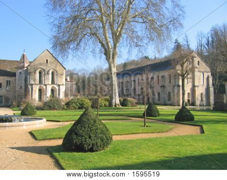 Church and its garden - Fonteney french abbey - France. poster