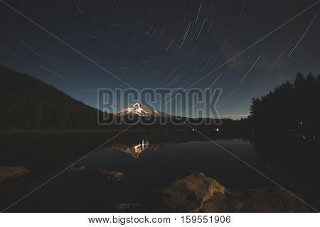 Star trails over Mount Hood and Trillium Lake, Oregon, United States.