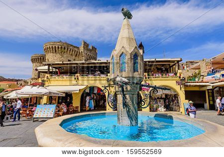 Rhodes island, Dodecanese, Greece - May 20, 2016: the beautiful Hippocrates square with an ancient fountain in the historic Old Town of Rhodes