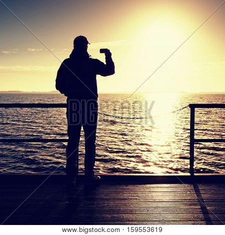 Smart Phone Artist Photograph Over  Handrail On Mole Sun Above Sea