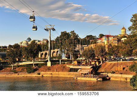 TBILISI GEORGIA - SEPTEMBER 27: View of the riverside and cable car in Tbilisi city centre Georgia on September 27 2015. Tbilisi is the capital and largest city of Georgia.