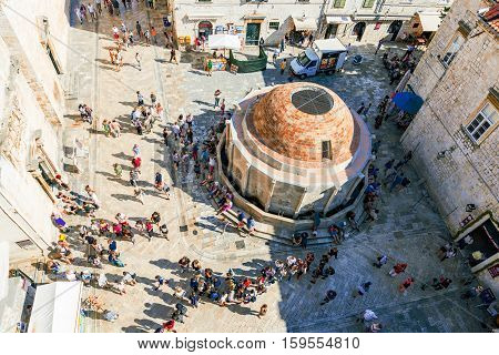 DUBROVNIK CROATIA - SEPTEMBER 22: This is an aerial view of the old town center in Dubrovnik where many tourists come to enter the castle walls on September 22 2016 in Dubrovnik
