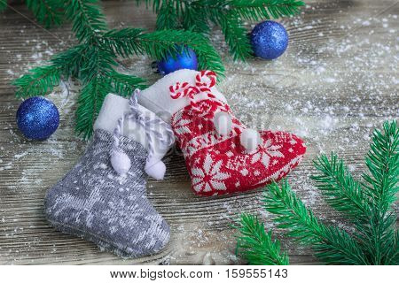 Christmas Stockings On Snowbound Wooden Background With Blue Balls Ornaments