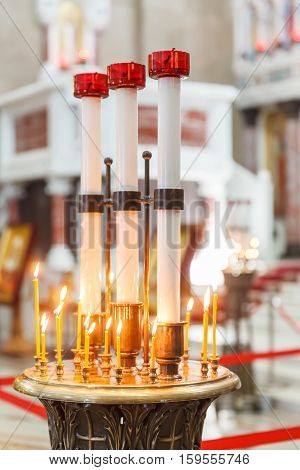 candles and St. Andrew's flag in Naval cathedral of Saint Nicholas in Kronstadt, St.-Petersburg, Russia