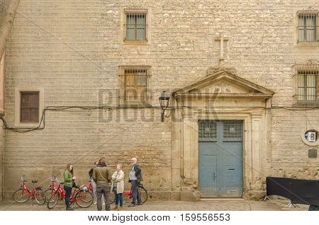 Tourists Looking For Direction In Plaza De Sant Felip Neri In Gothic District In Barcelona, Spain.
