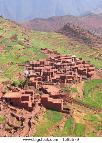 Moroccan berber village in the mountains with terrace culture - Setti Fadma Atlas - Ourika valley - Morocco. poster