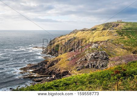 St. Just United Kingdom - August 11 2016: View of Kenidjack Cliff Castle from Cape Cornwall located in West Penwith AONB.