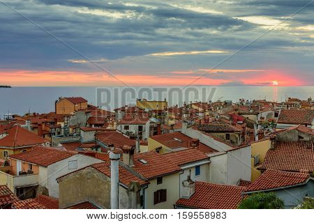Aerial view of Adriatic sea and the old town of Piran in Istria during a beautiful sunset, Slovenia.
