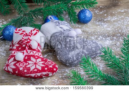 Christmas Stockings Pair On Snowbound Wooden Background With Blue Balls