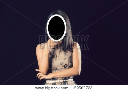 Anonymous girl in the studio against black background