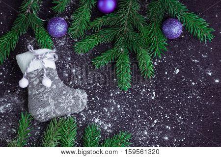 Grey Christmas Stocking On Snowbound Black Background With Purple Balls