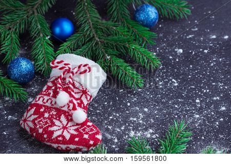Christmas Red Stocking On Snowbound Black Background With Blue Balls