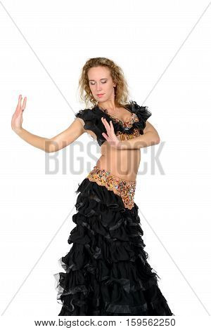 Young beautiful blonde in a black oriental dance costume on a white background isolated