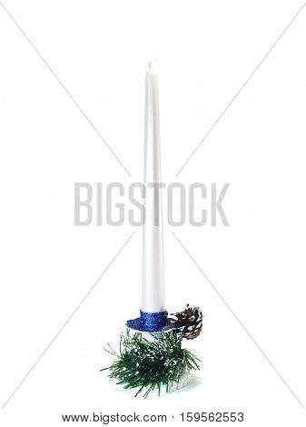 Candle on a candlestick and pine cone isolated on white background