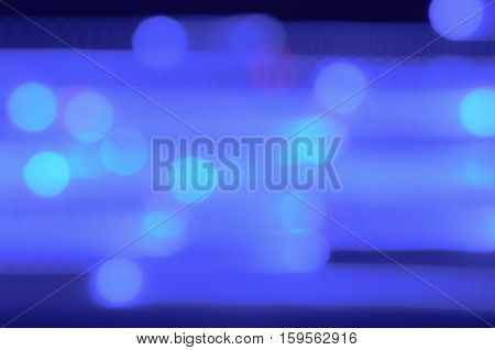 Blue Lights In Movement. Blurred Blue Background With Lights In Movement Going Around With Some Blue