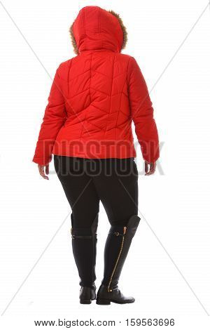 portrait of plus size model woman wearing XXL red warm winter coat and black leggins posing isolated on white background.