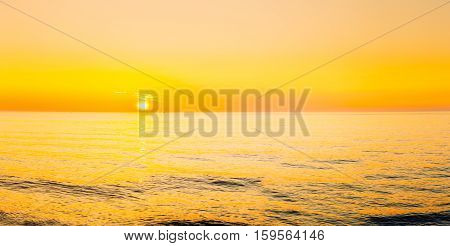 Sun Is Setting On Horizon At Sunset Sunrise Over Sea Or Ocean. Panorama Of Sea Ocean. Natural Sky Warm Colors. Panoramic View, Panorama. CopySpace.