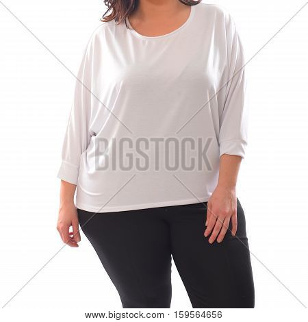 portrait of plus size model woman wearing XXL white sweater sweatshot and black leggins posing isolated on white background.