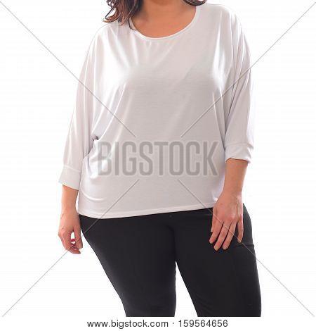 portrait of plus size model woman wearing XXL white sweater sweatshot and black leggins posing isolated on white background.