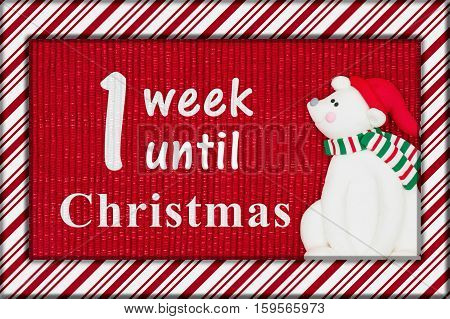 Christmas countdown message Red shiny fabric with a candy cane border and a Santa polar bear with text 1 week1 til Christmas 3D Illustration
