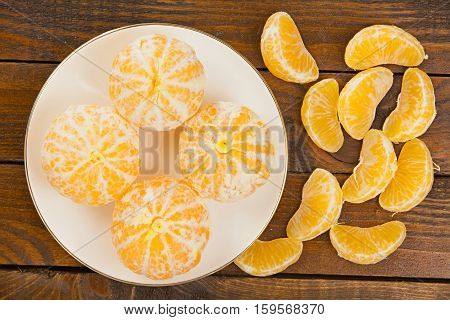 Juicy Spanish Mandarins On Plate On Wooden Background
