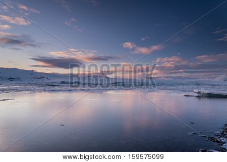 Jokulsarlon, Vatnajokull national park, Iceland during sunset in winter with reflection of the sky in water