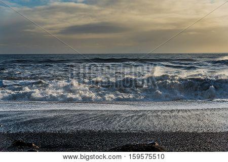Ocean wave on Reynisfjara or the black sand beach near the village called Vik i Myrdal, Iceland