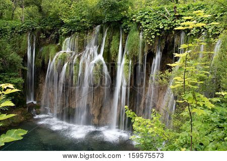 Beautiful waterfall in the upper lakes area (Gornja jezera), Plitvice lakes national park (Plitvicka Jezera), Lika-Senj county, Croatia.