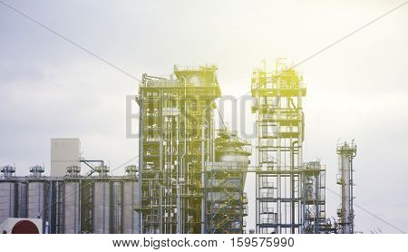 Modern chemical factory with lots of tubes - worldwide industry on a sunny day