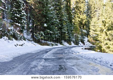 Ice on dangerous winding mountain road in Italy