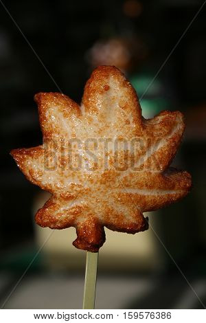 Japanese fried flavored fish cake shaped like maple leaf, famous snack from Miyajima, Japan