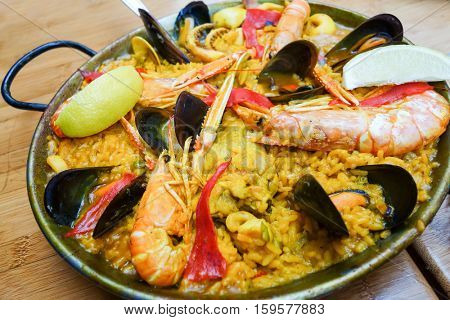 Prawn with rice - closeup of prawn with rice - traditionnal spanish food paella