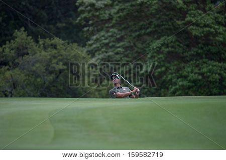 Sydney, Australia - November 19, 2016: Australian golfer Adam Scott playing a chip shot from behind the 6th green on day three of the Emirates Australian open at Royal Sydney Golf Club on November 19, 2016 in Sydney, Australia
