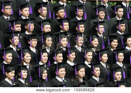 Bangkok Thailand - October 192016 : Crowd of student graduate class in caps and gowns standing in commencement event at university.