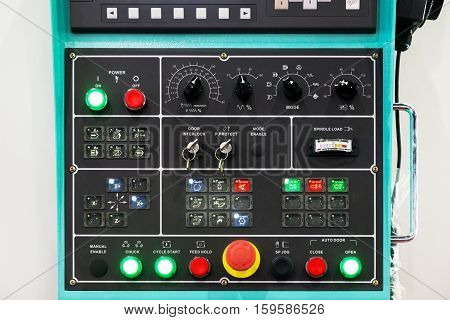 CNC machine control panel texture with lots of buttons in factory.