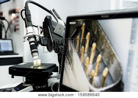 Microelectronics laboratory with the measuring instruments and microscopes.