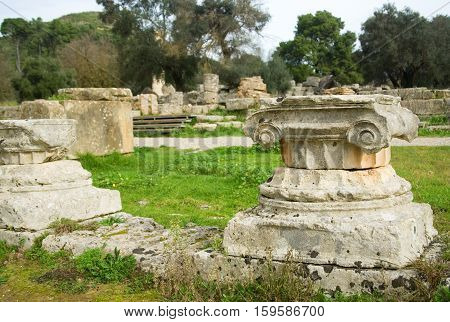 Ancient Columns In Archea Olympia, The Site Where The Olympic Games Were Held In Classical Times. Pe