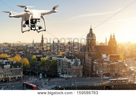 Drone with high resolution digital camera flying over Amsterdam historical city at Amsterdam Netherlands.