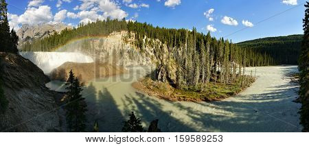 Waterfall in Canada and the mountains and a rainbow