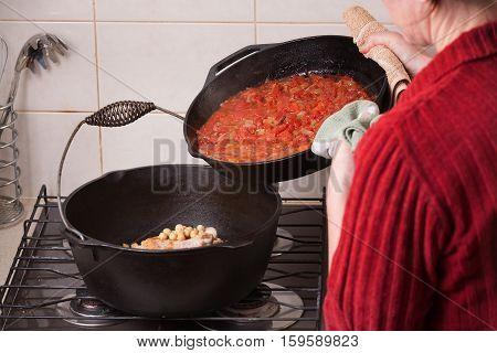 Ingredients being added to a home cooked meal