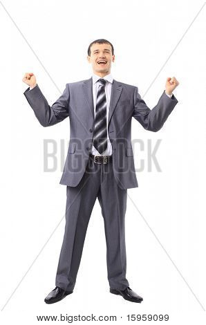 Portrait of a handsome young man in a business suit with his arms raised