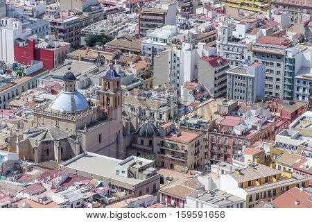 aerial view of some buildings of alicante with tehe co-cathedral of san nicolas de bari on the left